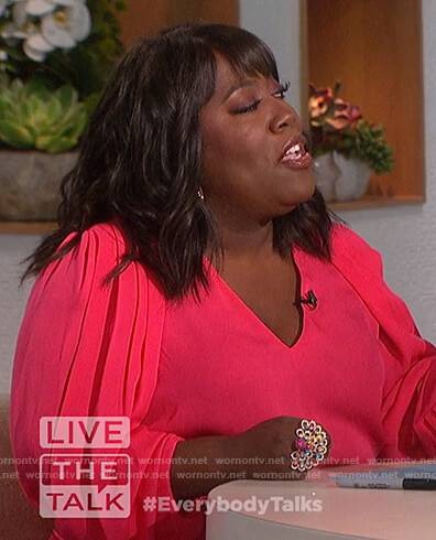 Sheryl's pink draped sleeve blouse on The Talk