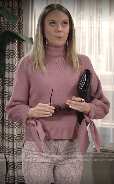 Abby's pink tie cuff turtleneck sweater and snake print jeans on The Young and the Restless