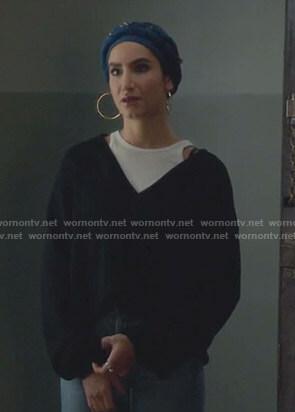 Adena's black v-neck sweater on The Bold Type