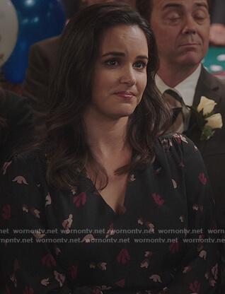 Amy's black floral v-neck dress on Brooklyn Nine-Nine