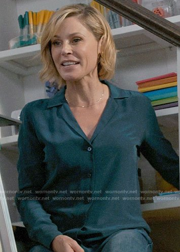 Claire's teal button down blouse on Modern Family