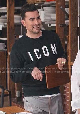 David's black Icon print sweatshirt and grey pants on Schitts Creek