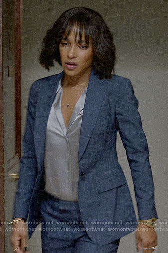Edie's blue suit and silver blouse on Almost Family