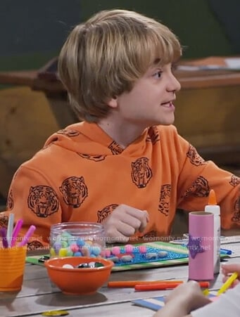 Finn's orange tiger print sweatshirt on Bunkd