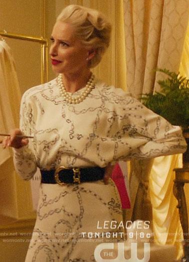 Gloria's white chain print dress on Katy Keene