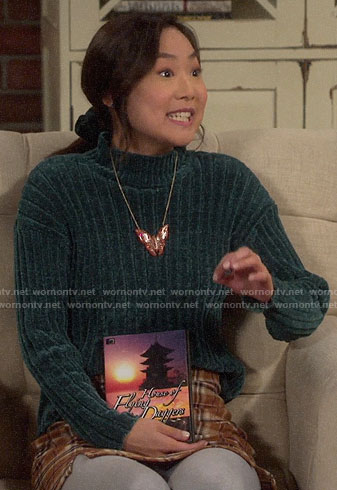 Jen's green chenille sweater and plaid skirt on Last Man Standing