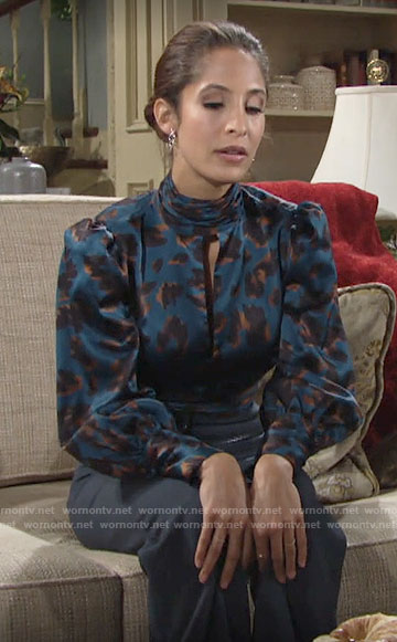 Lily's teal blue leopard print keyhole blouse on The Young and the Restless