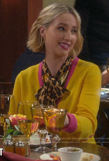 Mandy's yellow cardigan with pink trim and leopard blouse on Last Man Standing
