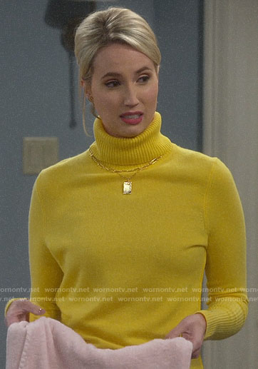 Mandy's yellow turtleneck sweater on Last Man Standing