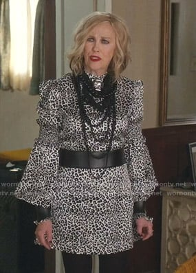 Moira's leopard print mock neck dress on Schitts Creek