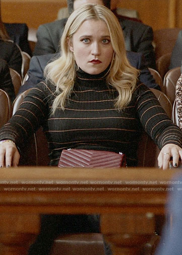 Roxy's black striped turtleneck on Almost Family