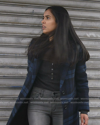 Saanvi's blue plaid coat on Manifest