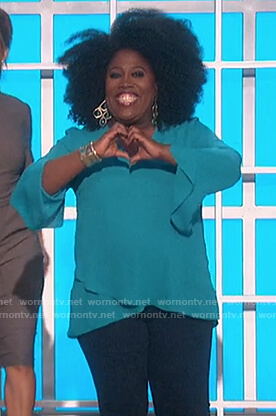 Sheryl's turquoise ruffle hem blouse on The Talk