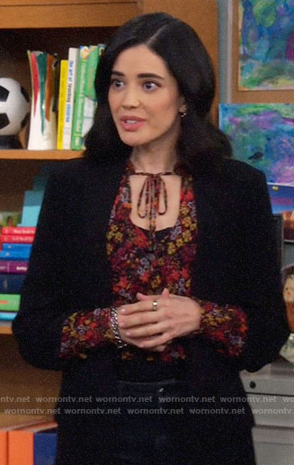 Sofia's floral blouse with tie on The Neighborhood