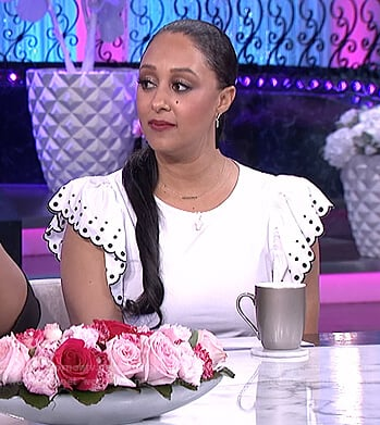 Tamera's white ruffle embroidered top on The Real