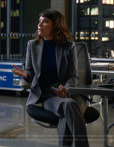 Taylor's grey suit on Bull