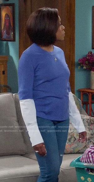 Tina's blue layered sweater on The Neighborhood