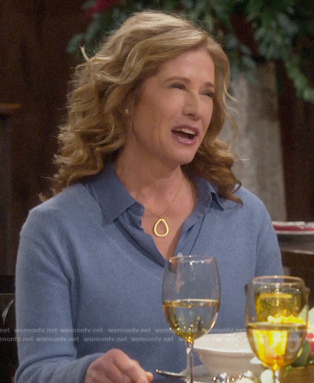 Vanessa's blue v-neck sweater and button down blouse on Last Man Standing