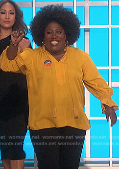 Sheryl's yellow tassel tie blouse on The Talk