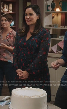 Amy's black floral pleated dress on Brooklyn Nine-Nine