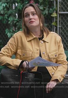 Angie's black stripe leather bag on Single Parents