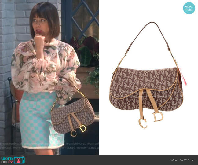 Oblique Double Saddle Bag by Christian Dior worn by Elizabeth (Natasha Leggero) on Broke