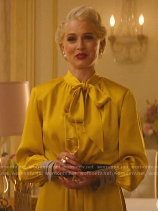 Gloria's yellow tie neck dress on Katy Keene