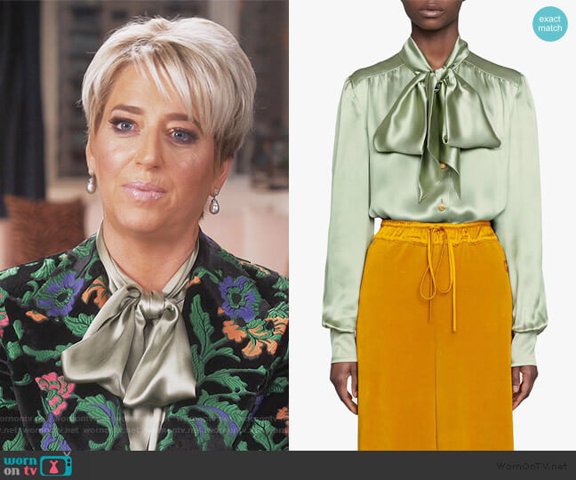 Satin shirt with neck bow by Gucci worn by Dorinda Medley  on The Real Housewives of New York City