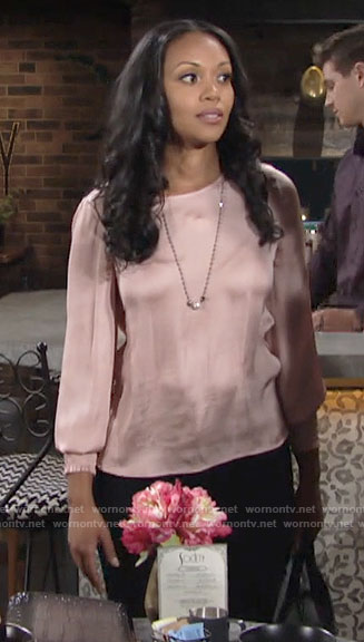 Amanda's pink smocked cuff blouse on The Young and the Restless