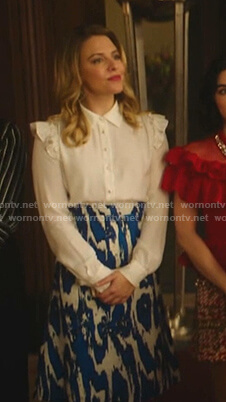 Amanda's white ruffle blouse and printed skirt on Katy Keene