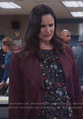 Amy's black floral blouse