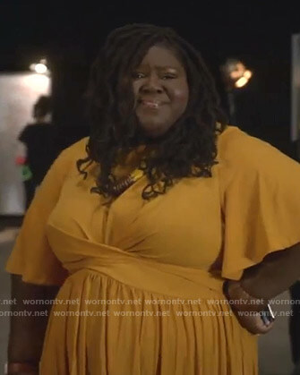 Becky's orange twist front dress on Empire