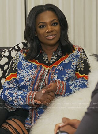 Kandi's blue floral printed blouse on The Real Housewives of Atlanta