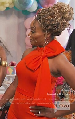 Cynthia's red bow shoulder jumpsuit on The Real Housewives of Atlanta
