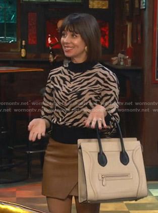 Elizabeth's zebra print sweater and leather mini skirt on Broke