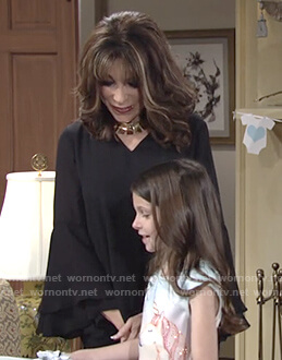Esther's black bell sleeve v-neck top on The Young and the Restless
