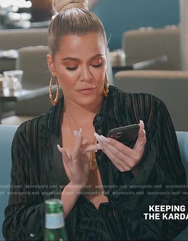 Khloe's black oversized stripe blouse on Keeping Up with the Kardashians