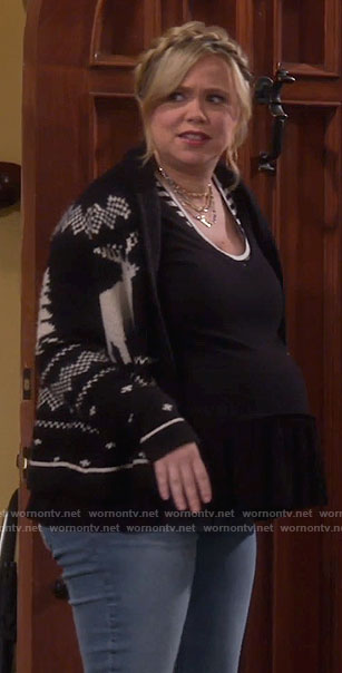 Kristin's black and white reindeer cardigan on Last Man Standing