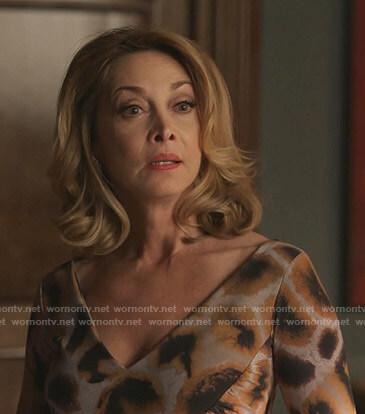 Laura's grey and orange print v-neck dress on Dynasty