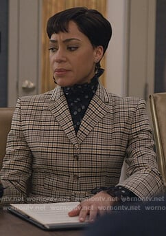 Lucca's polka dot blouse and plaid blazer on The Good Fight