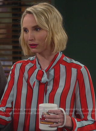 Mandy's stripe tie neck blouse on Last Man Standing