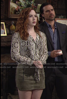 Mariah's snake print tie neck blouse and green suede skirt on The Young and the Restless
