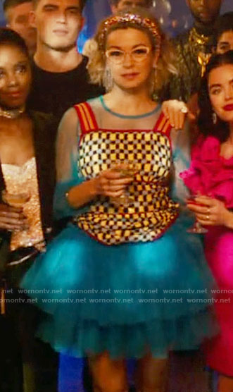 Pepper's blue tulle dress and checked knit top on Katy Keene
