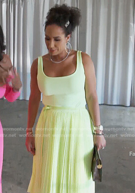Tanya Sam's neon pleated skirt on The Real Housewives of Atlanta