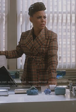 Tegan's beige plaid trench coat on How to Get Away with Murder