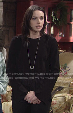 Tessa's black fringe hem top on The Young and the Restless