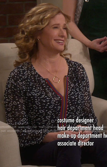 Vanessa's black printed split-neck top on Last Man Standing