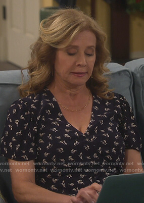 Vanessa's blue floral wrap top on Last Man Standing