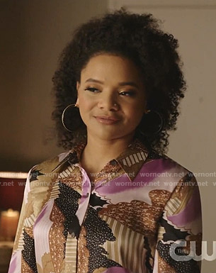 Vanessa's abstract print blouse and jeans on Dynasty