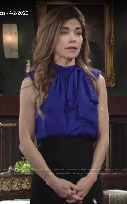 Victoria's sleeveless blue tie neck blouse on The Young and the Restless